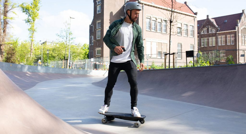 man on a electric skateboard